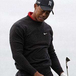 Tiger Woods reacts to another poor shot while playing the fourth hole of the South Course at Torrey Pines during the final round of the Farmers Insurance Open golf tournament in San Diego, Sunday, Jan. 30, 2011.