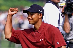 Tiger Woods celebrates after winning the 100th U.S. Open Golf Championship at the Pebble Beach Golf Links in Pebble Beach, Calif., Sunday, June 18, 2000. Finishing at 12 under par, Woods topped second-place Ernie Els by a remarkable 15 shots.