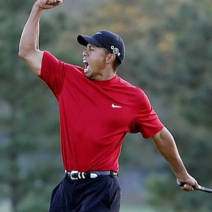 Tiger Woods reacts to winning the 2005 Masters in a playoff with Chris DiMarco on the 18th hole during final-round play at Augusta National Golf Club in Augusta, Ga.