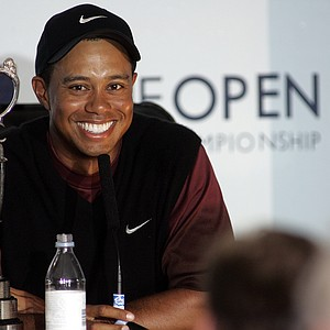 Tiger Woods speaks at a press conference with the trophy after winning the 2005 British Open on the Old Course at St. Andrews. (AP Photo/Ted S. Warren)