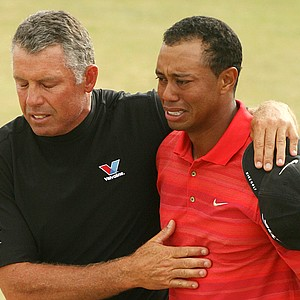 Tiger Woods, right, reacts as he walks off the 18th green with his caddie Steve Williams after winning the British Open Golf Championship at the Royal Liverpool Golf Course in Hoylake, England Sunday July 23, 2006. The win was Woods' first major title since the death of his father, Earl.