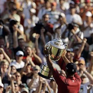 Tiger Woods holds up the Wanamaker Trophy after winning the 89th PGA Golf Championship at the Southern Hills Country Club in Tulsa, Okla., Sunday, Aug. 12, 2007. The win was Tiger's 13th major title.