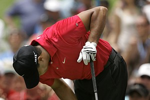 Tiger Woods holds his left knee after teeing off on the second hole during the fourth round of the 2008 U.S. Open at Torrey Pines in San Diego. Woods had reconstructive surgery on his left knee Tuesday, June 24, 2008, in Utah to repair a torn ligament. Woods went on to win in a playoff over Rocco Mediate.