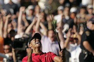 Tiger Woods reacts after sinking a birdie putt on the 18th green, forcing a playoff against Rocco Mediate during the final round of the 2008 U.S. Open at Torrey Pines in San Diego.
