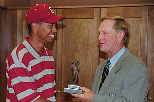 Tiger Woods shakes hands with Jack Nicklaus after receiving the Jack Nicklaus College Player of the Year award in ceremonies at the Memorial Tournament in Dublin, Ohio, Sunday, June 2, 1996.