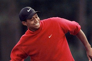 Tiger Woods celebrates as he wins the 1997 Masters with a record-breaking 18-under-par performance at the Augusta National Golf Club in Augusta, Ga., Sunday, April 13, 1997. (AP Photo/Curtis Compton)