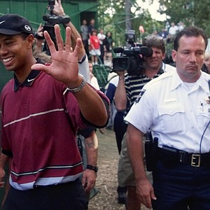 Tiger Woods waves to fans after he won the 81st PGA Championship at the Medinah Country Club in Medinah, Ill., on Sunday, Aug. 15, 1999. Woods shot an 11-under 277, beating Sergio Garcia, of Spain, by one stroke. (AP Photo/Beth A. Keiser)