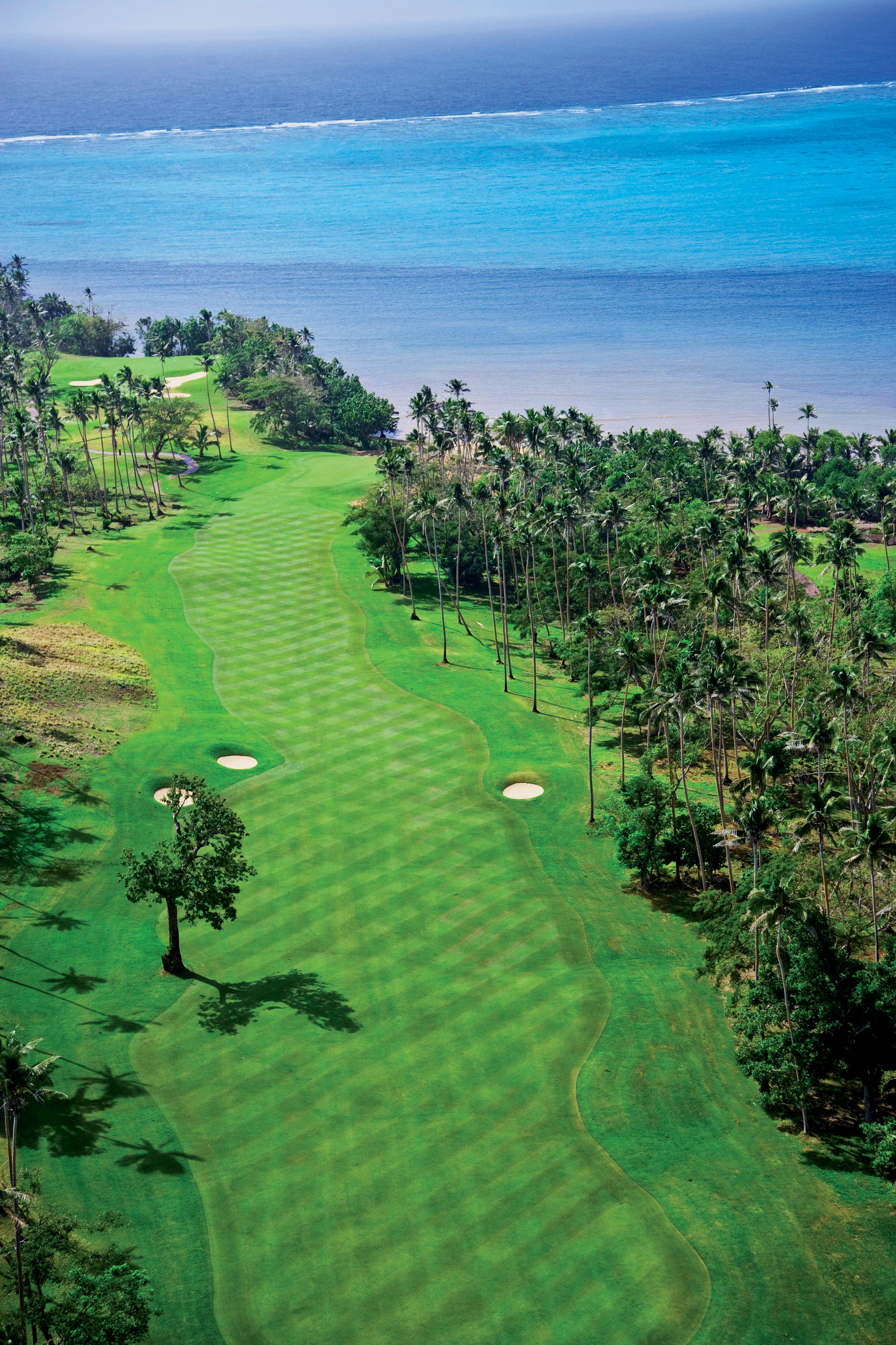 The 12th hole at Laucala stretches to the South Pacific.
