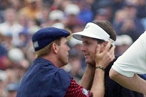 Payne Stewart talks with Phil Mickelson after Stewart made par at No. 18 to beat Mickelson and win the 1999 U.S. Open at Pinehurst No. 2.