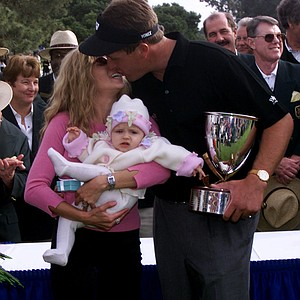 Phil Mickelson kisses his wife Amy after winning the 2000 Buick Invitational. With the win, Mickelson ended Tiger Woods' six-year winning streak at the tournament. Mickelson finished at 18-under par, four shots ahead of Woods.