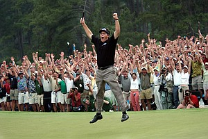 Phil Mickelson celebrates his first major title at the 2004 Masters. Mickelson finished at 9 under at Augusta National to claim the first of two green jackets.