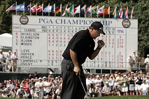 Phil Mickelson reacts to a birdie at the final hole of the lightning-delayed PGA Championship in 2005. Mickelson went 4 under for the week at Baltusrol Golf Club to win his second major title.