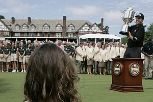 Phil Mickelson accepts the trophy at the 2005 PGA Championship at Baltusrol Golf Club as daughter Amanda watches. Mickelson was at 4 under for the tournament.