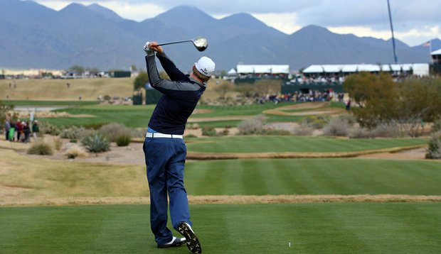 Hunter Mahan tees off at the 2010 Waste Management Phoenix Open.