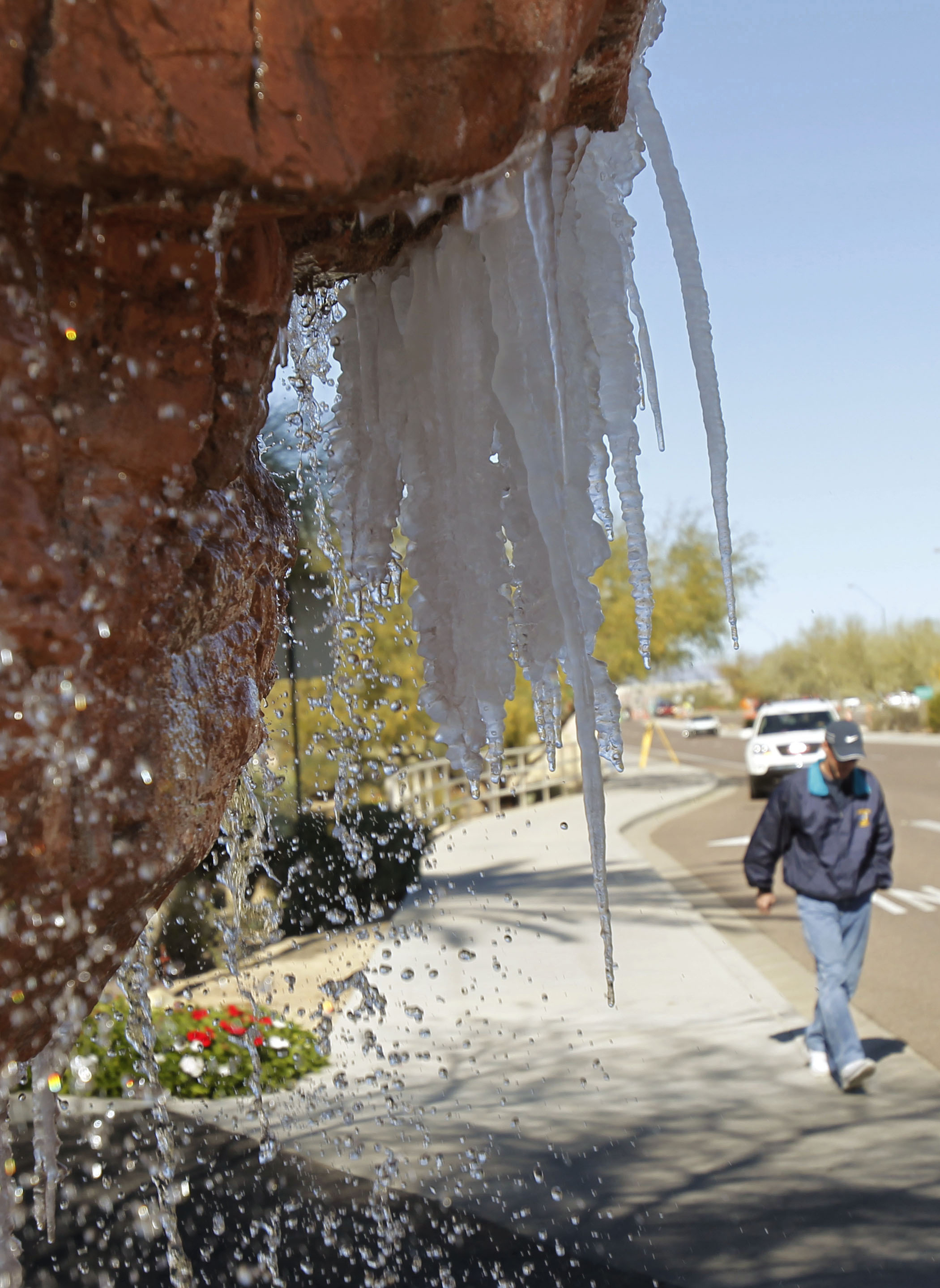 An icicle forms on a fountain near TPC Scottsdale.