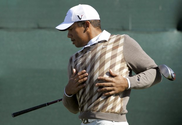 Jhonattan Vegas, of Venezuela, warms up on the first tee prior to the first round of the Waste Management Phoenix Open PGA golf tournament Thursday, Feb. 3, 2011, in Scottsdale, Ariz.