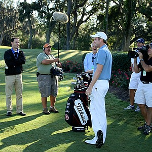 A Golf Channel television crew films Nationwide Tour player Chris Kirk at the 17th hole at TPC Sawgrass.