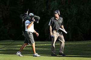 On-course reporter Jerry Foltz, right, with cameraman Lewis Estes during the Children's Miracle Network Classic.