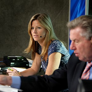 Golf Channel anchors Kelly Tilghman, left, and Peter Oosterhuis prepare for live coverage from the on-course booth at the Children's Miracle Network Classic.