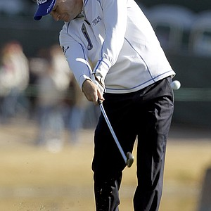 Second-round co-leader Mark Wilson hits a shot Friday at TPC Scottsdale.