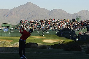 Charlie Wi tees off at TPC Scottsdale's 16th hole during Round 2 of the Phoenix Open. Cold temperatures resulted in smaller crowds at the traditionally boisterous event.
