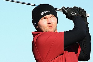 Tommy Gainey, whose signature two gloves come in handy Friday at the Waste Management Phoenix Open, is among the many players bundled up in the desert.