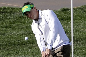 Mark Wilson chips to the ninth green during the second round of the Phoenix Open.