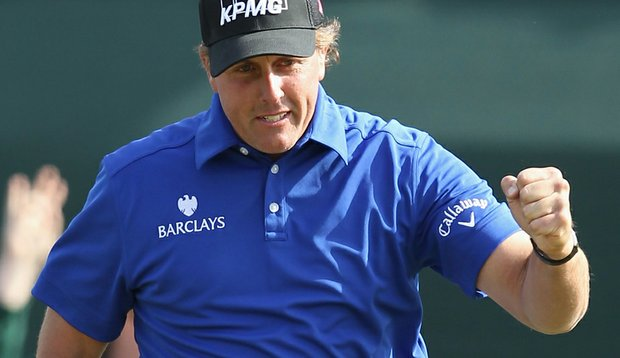 Phil Mickelson celebrates after his birdie putt on the 16th hole during the second round of the Waste Management Phoenix Open at TPC Scottsdale on February 5, 2011.