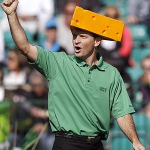 Mark Wilson wears a Green Bay Packers cheesehead as he chants with the crowd at the 16th hole during the third round of the Phoenix Open on Sunday, Feb. 6, 2011, in Scottsdale, Ariz.