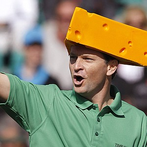 "Wearing a Green Bay Packers ""cheesehead,"" Mark Wilson cheers on the crowd at the 16th hole during the third round of the Waste Management Phoenix Open, which he went on to win in a playoff over Jason Dufner."