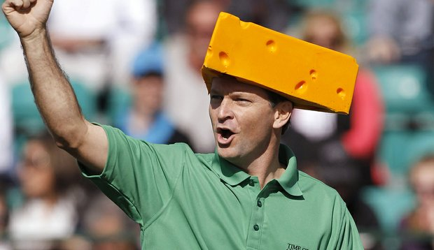"""Wearing a Green Bay Packers """"cheesehead,"""" Mark Wilson cheers on the crowd at the 16th hole during the third round of the Waste Management Phoenix Open, which he went on to win in a playoff over Jason Dufner."""