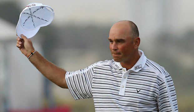 Thomas Bjorn of Denmark celebrates after winning the Qatar Masters at the Doha Golf Club on February 6, 2011.