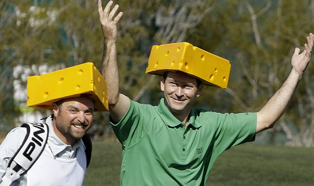Mark Wilson, right, gets the crowd going as he and his caddie Chris Jones arrive at the 16th green wearing Green Bay Packers cheeseheads hats during the third round of the Phoenix Open on Sunday, Feb. 6, 2011, in Scottsdale, Ariz.