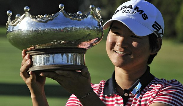 Defending champion Yani Tseng holds the trophy at the Women's Australian Open.