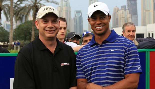 Army Lt. Col. Michael Rowells, enjoying some R&R while his 401st Field Support Brigade is deployed in Afghanistan, enjoys a dream pairing with Tiger Woods during the pro-am Feb. 9 at the Omega Dubai Desert Classic.