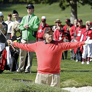 Chris Berman acknowledges applause after hitting out of a bunker on the second hole during the celebrity challenge of the AT&T Pebble Beach National Pro-Am Wednesday, Feb. 9, 2011, in Pebble Beach, Calif.