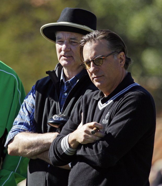 Actors Bill Murray, left, and Andy Garcia watch play on the first green during the celebrity challenge of the AT&T Pebble Beach National Pro-Am Wednesday, Feb. 9, 2011, in Pebble Beach, Calif.