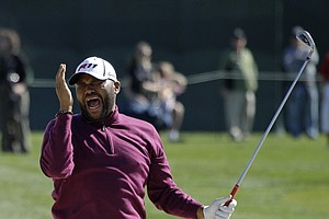 Actor Anthony Anderson reacts after hitting the ball out of a bunker on the 18th fairway during the celebrity challenge event of the AT&T Pebble Beach National Pro-Am in Pebble Beach, Calif., Wednesday, Feb. 9, 2011.