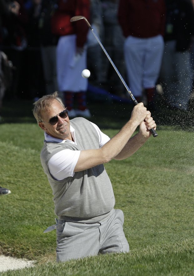 Actor Kevin Costner hits the ball out of a bunker up to the 18th green during the celebrity challenge event of the AT&T Pebble Beach National Pro-Am in Pebble Beach, Calif., Wednesday, Feb. 9, 2011.