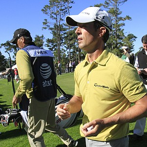 Mike Weir exits the ninth fairway on the Spyglass Hill course during the first round of the Pebble Beach National Pro-Am Thursday, Feb. 10, 2011, in Pebble Beach, Calif.