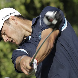 World No. 2 Martin Kaymer hits a drive on the 14th hole during an opening-round 69 in Dubai.