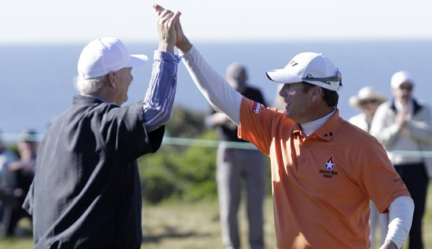 D.A. Points, right, is greeted by actor Bill Murray, left, after chipping in for a birdie on the 16th green of the Monterey Peninsula Country Club during the first round of the Pebble Beach National Pro-Am in Pebble Beach, Calif., Thursday, Feb. 10, 2011.