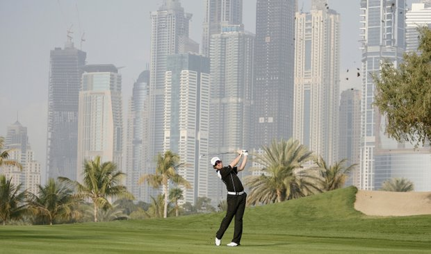 Rory McIlroy, who shot a tournament-leading 65 in Round 1, plays a shot from the 13th fairway.