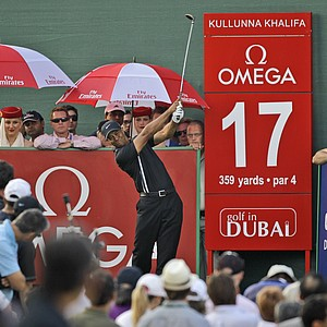 Tiger Woods tees off on the 17th hole during the opening round of the Dubai Desert Classic. Woods shot 71.