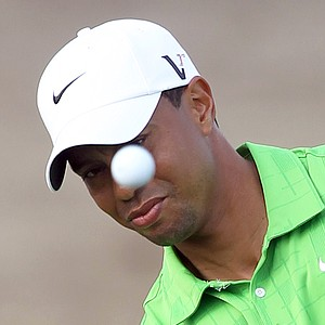 Tiger Woods plays a shot on the second day of the Dubai Desert Classic golf tournament in the Gulf emirate on February 11, 2011. Woods struggled the previous day coming third best after Lee Westwood and Martin Kaymer in a rare showdown opposing the world's top three golfers.