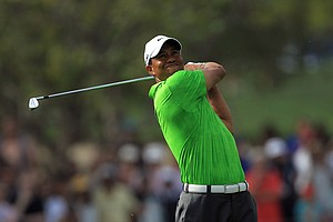 Tiger Woods of the USA plays his second shot at the 1st hole during the second round of the 2011 Omega Dubai Desert Classic on the Majilis Course at the Emirates Golf Club on February 11, 2011 in Dubai, United Arab Emirates.