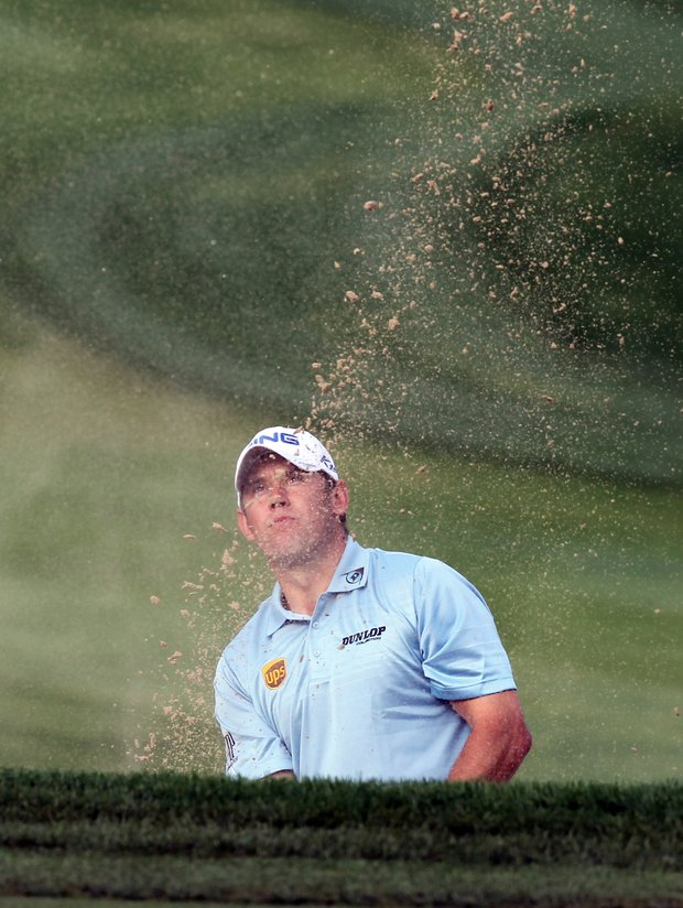 Lee Westwood plays a shot on the second day of the Dubai Desert Classic golf tournament in the Gulf emirate on February 11, 2011 as the battle for world golf supremacy is contested in Dubai this week with the top three in the rankings - Lee Westwood, Martin Kaymer and Tiger Woods - in the same group for the first two rounds.