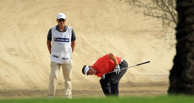 Pablo Martin of Spain in the desert for his second shot at the 14th hole during the second round of the 2011 Omega Dubai Desert Classic on the Majilis Course at the Emirates Golf Club on February 11, 2011 in Dubai, United Arab Emirates.