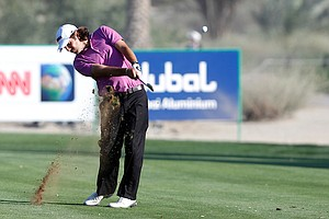 Thomas Aiken holds a share of the lead with Anders Hansen and Rory McIlroy entering the final round of the Dubai Desert Classic.