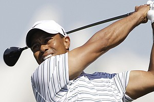 Tiger Woods tees off on the fifth hole during Round 3 of the Dubai Desert Classic.